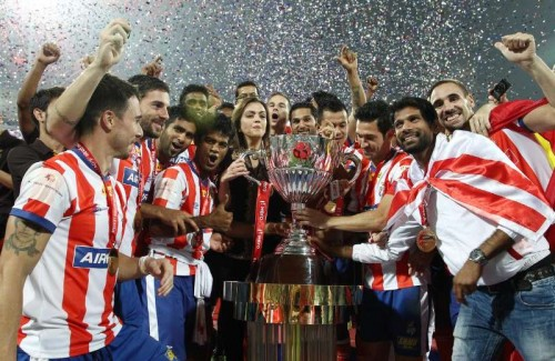 Atletico de Kolkata players celebrates after defeating Kerala Blasters FC to clinch the first ISL trophy at at D.Y Patil Stadium, in Mumbai on Dec 20, 2014.