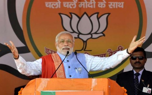 Hazaribagh: Prime Minister Narendra Modi addresses during an election rally ahead of third phase of Jharkhand assembly elections at Hazaribagh, Jharkhand on Dec. 6, 2014. (Photo: IANS)