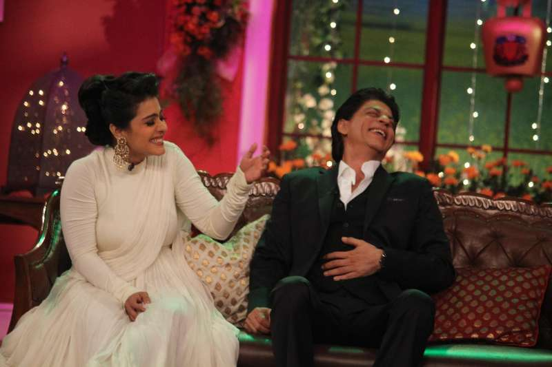 The evergreen couple Kajol and Shahrukh Khan on the sets of Comedy Nights With Kapil reliving the good old days at Dilwale Dulhania Le Jayenge 1000 weeks completion special episode shoot on Comedy Nights With Kapil in Mumbai. They are appearing together again in Dilwale