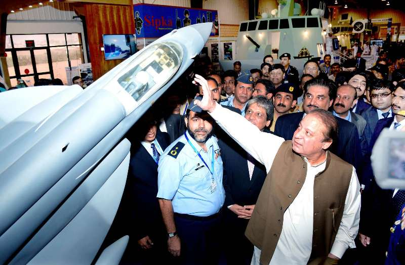 Pakistani Prime Minister Nawaz Sharif visiting a stall during the 8th International Defense Exhibition and Seminar (IDEAS) at Expo Center in Karachi, Pakistan, Dec. 1, 2014. The IDEAS 2014 is an exhibition of defense equipments and weapons of 232 defense companies from across the world.