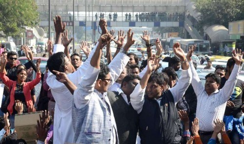 Catholics stage a protest outside the Delhi Police headquarters to demand a judicial probe, a day after a church was gutted in New Delhi on Dec 2, 2014. A Catholic church in east Delhi's Dilshad Garden area was gutted under mysterious circumstances on Monday (1st December).