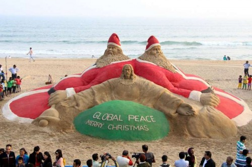 Renowned sand artist Sudarsan Pattnaik's sand sculpture calls for global peace on Christmas eve at Puri beach, Odisha on Dec 25, 2014.