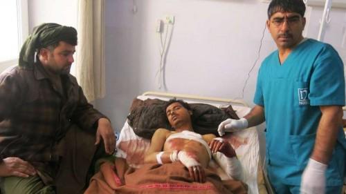 An injured man receives treatment at a hospital