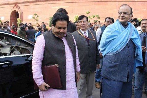 Union Minister for Finance, Corporate Affairs, and Information and Broadcasting Arun Jaitley and Congress MP Rajeev Shukla at the Parliament premises in New Delhi.