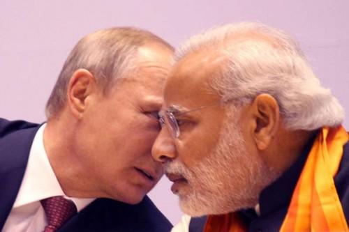 "Prime Minister Narendra Modi and Russian President Vladimir Putin at the ""World Diamond Conference"" in New Delhi, on Dec 11, 2014."