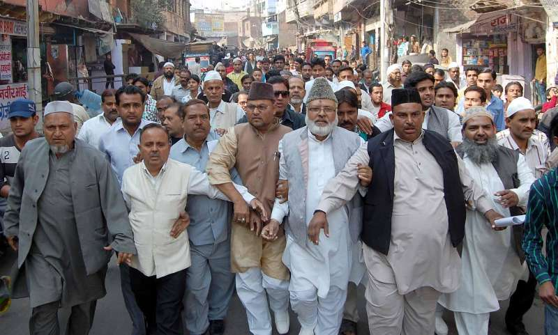 Agra: Muslims stage a demonstration against the reported conversion of 60 Muslim families living in a slum on Agra's outskirts, in Agra on Dec 10, 2014. (Photo: IANS)