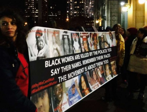 People attend a demonstration to protest against racism and police violence in Manhattan, New York, U.S., the United States, Dec. 13, 2014.