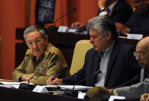 Cuba's President Raul Castro and Cuban first Vice President Miguel Diaz-Canel (C) participate in the 4th Ordinary Session of the 8th Legislature of the National Assembly of People's Power (Parliament), at the Palace of Conventions, in Havana, Cuba, on Dec. 19, 2014. According to local press, Cuban Parliament on Friday unanimously approved a declaration of support for the speech of Raul Castro on relations between the United States and Cuba.