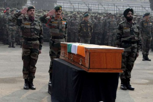 Chief of Army Staff, General Dalbir Singh pay tributes to the soldiers martyred on Friday`s attacks in Jammu and Kashmir at Muhara Uri Army camp, Badami Bagh Cantonment in Srinagar on Dec. 6, 2014.