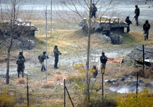 Soldiers take position during an encounter with heavily-armed militants who mounted an audacious attack on Indian Army's Field Ordinance Camp at Mohra near the border town of Uri in Baramulla district of Jammu and Kashmir on Dec 5, 2014.