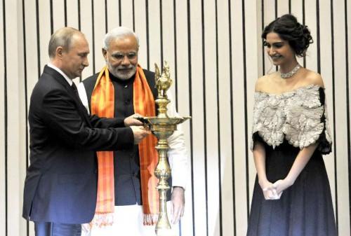 Prime Minister Narendra Modi, the President of Russian Federation, Vladimir Putin and actress Sonam Kapoor at the inauguration of the `World Diamond Conference`, in New Delhi on Dec 11, 2014.