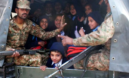 Pakistani soldiers transport rescued school children from the site of an attack by Taliban gunmen on a school in northwest Pakistan's Peshawar on Dec. 16, 2014. The death toll of a terror attack on a school in Peshawar of Pakistan's northwest Khyber Pakhtunkhwa