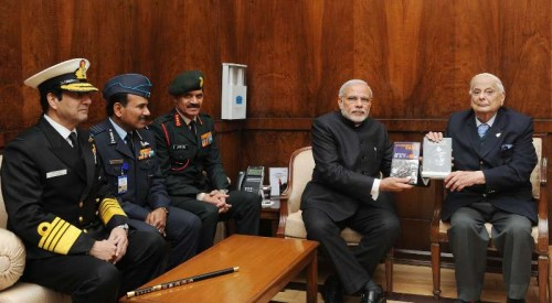 "The Lt. General (Retd.) JFR Jacob presenting his book ""An Odyssey in War & Peace"" and ""Surrender at Dacca"" to the Prime Minister, Shri Narendra Modi, in New Delhi on December 16, 2014. The Chief of Army Staff, General Dalbir Singh, the Chief of Naval Staff, Admiral R.K. Dhowan and the Chief of the Air Staff, Air Chief Marshal Arup Raha are also seen."