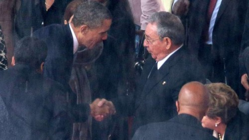 THE HANDSHAKE THAT BEGAN IT ALL: Obama shakes the hands of President Raul Castro at the funeral of Mandela in South Africa last year.