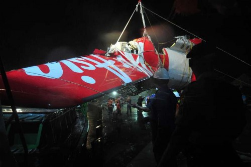The tail part of crashed AirAsia flight QZ8501 is transferred from Crest Onyx ship in the port of Kumai, Pangkalan Bun, Indonesia, Jan. 11, 2015.