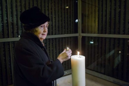 A woman holds a candle for her killed relatives before the memorial wall at the Holocaust Memorial Center in Budapest, capital of Hungary. On Jan. 27, 1945, Soviet troops liberated Auschwitz, the largest Nazi concentration camp in Poland where over one million people were killed. In 2005, The United Nations designated the same day as the international Holocaust Memorial Day in memory of the victims of the Holocaust.