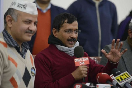 Aam Aadmi Party (AAP) leaders Arvind Kejriwal and Manish Sisodia address a press conference in New Delhi