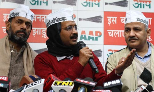 Aam Aadmi Party (AAP) leader Arvind Kejriwal addresses press in New Delhi, on Jan 10, 2015. Also seen Yogendra Yadav and Manish Sisodia.