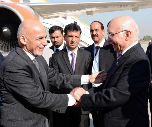 Photo released by Press Information Department (PID) on Nov. 14, 2014 shows Afghan President Ashraf Ghanibeing welcomed by Sartaj Aziz National Security Advisor to the Prime Minister on National Security and Foreign Affairs of Pakistan at the Nur Khan air base in Rawalpindi, Pakistan. Afghan President Ashraf Ghani arrived in Pakistan on Friday for a two-day official visit for important talks on key security issues and expanding economic ties, officials said.