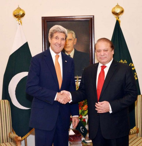 Photo released by Pakistan's Press Information Department (PID) on Jan. 12, 2015 shows Pakistani Prime Minister Nawaz Sharif (R) shaking hands with US Secretary of State John Kerry in Islamabad, capital of Pakistan. John Kerry on Monday assured support to Pakistan in his meeting with Nawaz Sharif in Islamabad, officials said. Kerry arrived in Islamabad Monday evening on a two-day visit following his trip to India.