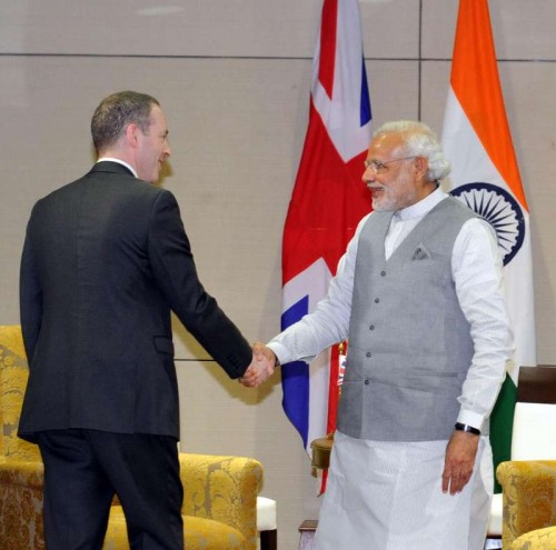 Prime Minister Narendra Modi meets the Minister of State for Trade & Investment of UK, Lord Ian Livingston, at New Sachivalaya, in Gandhinagar, Gujarat on Jan 10, 2015.