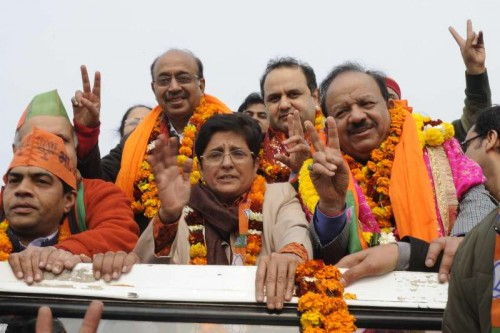 BJP leader Kiran Bedi with party leader Vijay Goel, Union Minister for Science & Technology and Earth Sciences Dr. Harsh Vardhan and others proceeds to file her nomination papers for upcoming Delhi assembly polls at Krishna Nagar, Delhi on Jan 21, 2015.