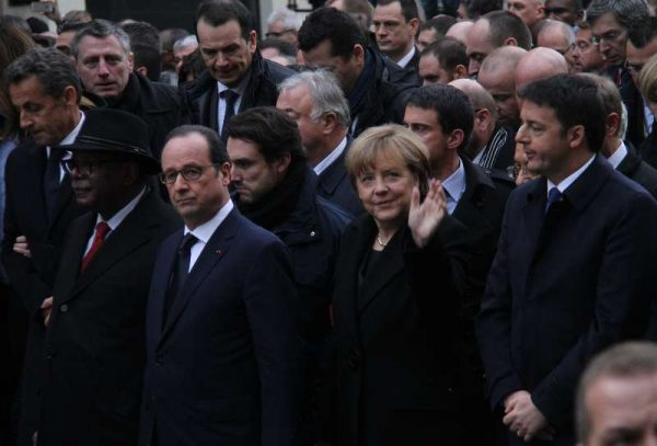 French President Francois Hollande German Chancellor Angela Merkel and Italian Prime Minister Matteo Renzi take part in a march in Paris, France, Jan. 11, 2015. A massive march commenced Sunday afternoon in Paris with the participation of French President Francois Hollande and leaders from dozens of foreign countries. More than a million French would walk in the streets of Paris in honor of the 17 victims killed during the three days deadly terrorist attack.