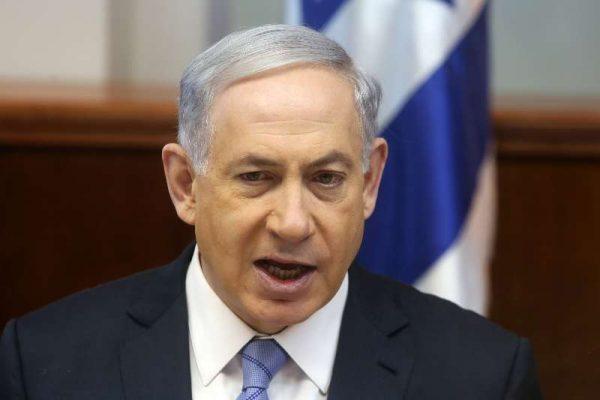Israeli Prime Minister Benjamin Netanyahu addresses the weekly cabinet meeting in his office in Jerusalem.