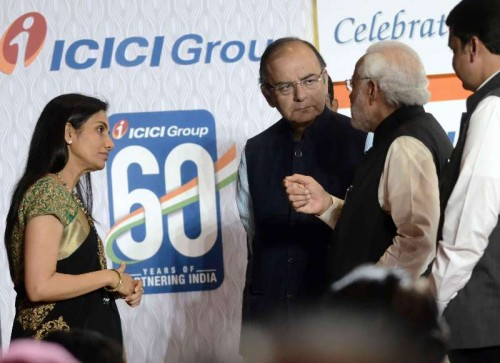 Prime Minister Narendra Modi with  Arun Jaitley  during a programme organised to celebrate 60th anniversary of ICICI Bank in Mumbai, on Jan 2, 2015. (Photo: Sandeep Mahankal/IANS)