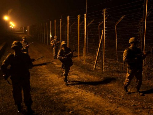 Soldiers on patrol duty along Indo-Pak border in Samba district of Jammu and Kashmir on Jan 6, 2015.