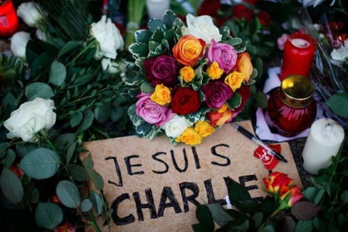"Flowers, candles, a pen and a poster saying ""I am Charlie"" are laid in front of the French Embassy in Berlin to commemorate the victims of the attack on French satirical weekly ""Charlie Hebdo"", in Berlin, Germany, on Jan. 9, 2015. Twelve people were killed on Wednesday in a shooting at the Paris office of Charlie Hebdo weekly."