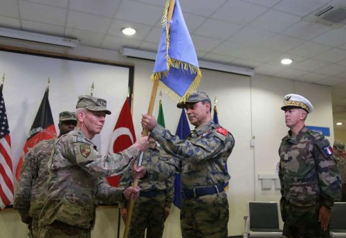 NATO Air Command-Afghanistan Commander U.S. Major General John K. McMullen (L, front) gives ceremonial flag to incoming commander Major General Mehmet Cahit Bakir (2nd R) during the change of command ceremony of Hamid Karzai International Airport from France to Turkey in Kabul, Afghanistan, Dec. 31, 2014.