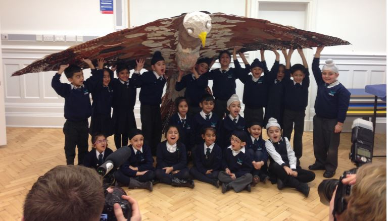Students of Falcon Primary School with their falcon bird