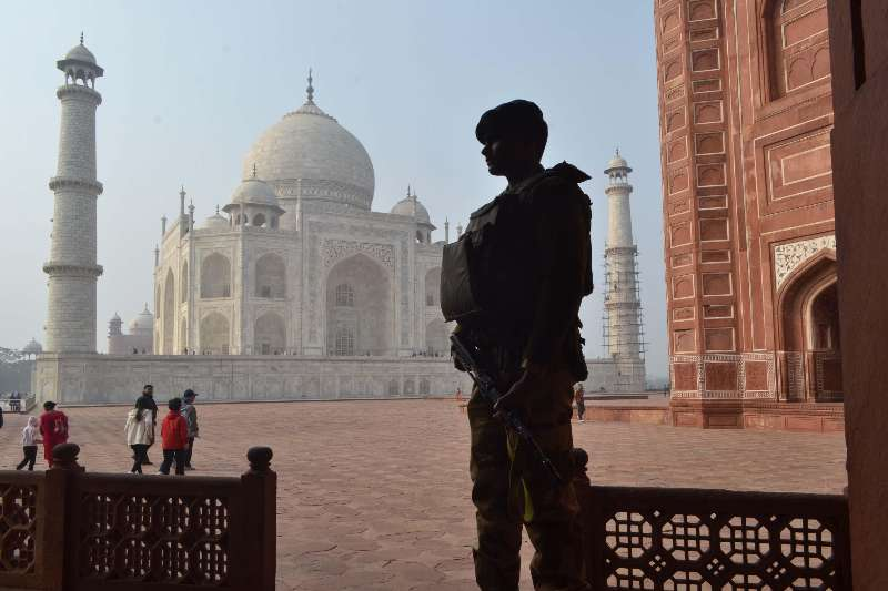 A soldier stands guard at the Taj Mahal