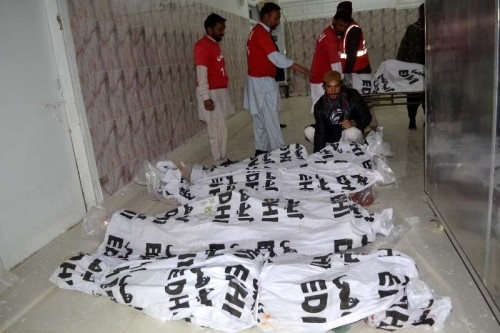 Pakistani security personnel identify the bodies of militants killed at a hospital in southwest Pakistan's Quetta.