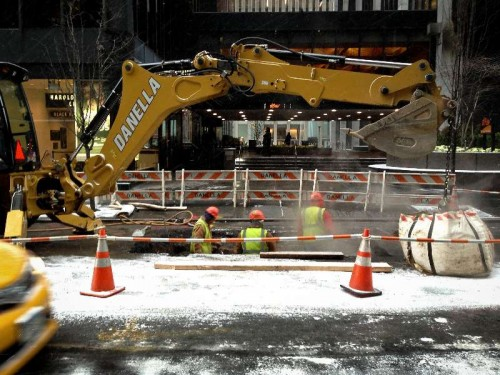 Workers conduct road maintenance operation  before bad weather hits New York.