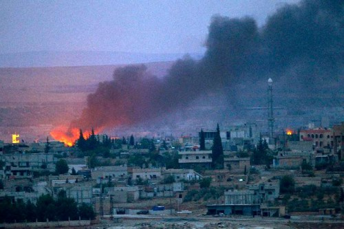 Smoke rises after an US airstrike on positions of Islamic State (IS) terror group in Kobani, Syria, on Oct. 15, 2014. The airstrikes initiated by a US-led coalition against IS continued in the southtern part of Syrian border city of Kobane.