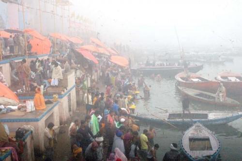 Devotees throng the banks of Ganga river for the holy dip on Makar Sankranti in Varanasi on Jan 14, 2015.