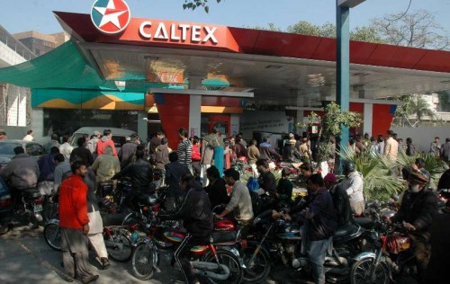 Motorbike riders queue at a fuel station due to petrol shortage in east Pakistan's Lahore, Jan. 16, 2015. Shortage of petrol continued on the fourth day in various areas of Punjab including Lahore whereas Federal Minster for Petroleum Shahid Khaqan Abbasi has assured that situation will be improved.