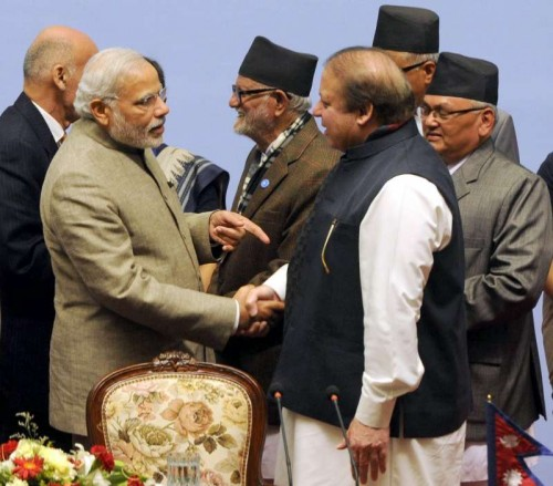 Prime Minister Narendra Modi shakes hands with Prime Minister of Pakistan, Nawaz Sharif at the 18th SAARC Summit, in Nepal on Nov 27, 2014. Also seen Prime Minister of Nepal Sushil Koirala.