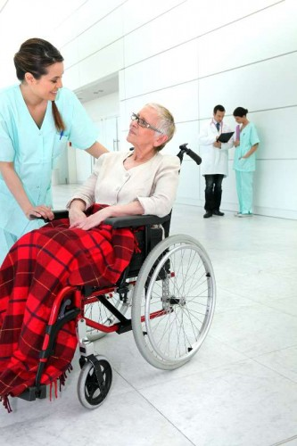 Woman in wheelchair taken care of