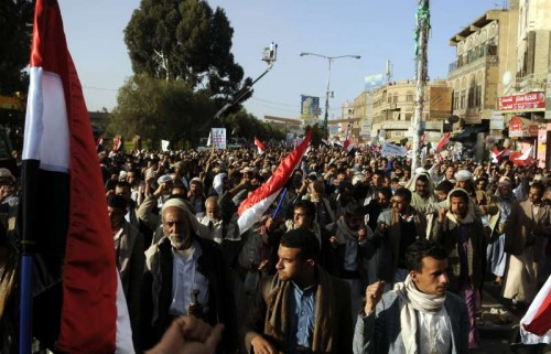 Yemeni people shout slogans during a rally marking the fourth anniversary of the 2011 revolution, in which former President Ali Abdullash Saleh was forced to step down, in Sanaa, Yemen, Feb. 11, 2015.