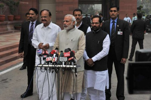 Prime Minister Narendra Modi addresses press ahead of the Budget Session of Parliament in New Delhi, on Feb 23, 2015. Also seen the Union Minister for Urban Development, Housing and Urban Poverty Alleviation and Parliamentary Affairs M. Venkaiah Naidu, the Union Minister of State for Skill Development and Entrepreneurship (Independent Charge) and Parliamentary Affairs Rajiv Pratap Rudy and and the Union Minister of State for Minority Affairs and Parliamentary Affairs Mukhtar Abbas Naqvi.