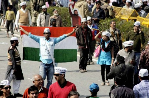 Aam Aadmi Party (AAP) supporters at the swearing-in ceremony of Delhi Chief Minister Arvind Kejriwal at Ramlila Maidan in New Delhi, on Feb 14, 2015.