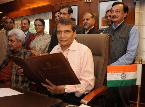 The Union Minister for Railways Suresh Prabhakar Prabhu gives finishing touches to the Railway Budget 2015-16, in New Delhi on Feb 25, 2015. Also seen the Union Minister of State for Railways Manoj Sinha and others.