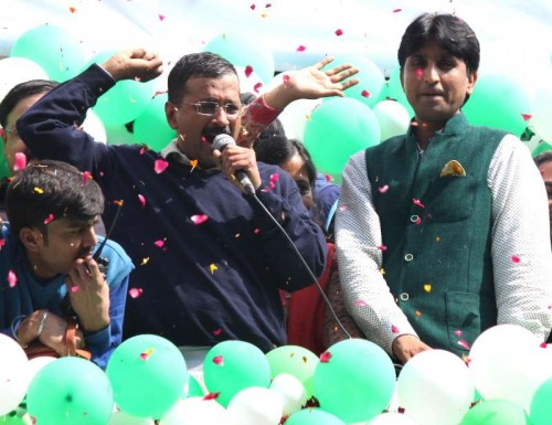 Aam Aadmi Party (AAP) leaders Arvind Kejriwal and Kumar Vishwas celebrate party's performance in the recently concluded Delhi Assembly Polls in New Delhi, on Feb 10, 2015.