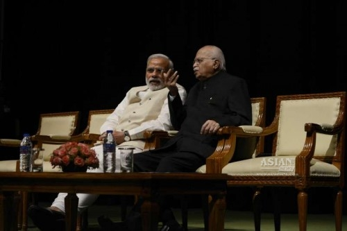 Prime Minister Narendra Modi with BJP MP from Gandhinagar L K Advani at the Parliament ahead of the budget session of the house in New Delhi