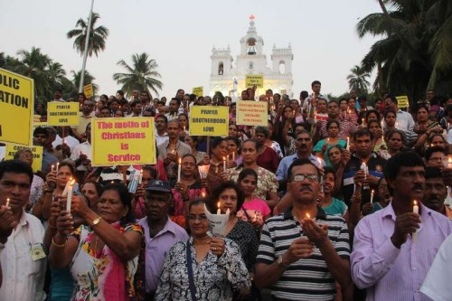 Catholic community under the banner of Catholic Association Of Goa carried a candle light vigil to highlight the concern over the attacks on churches in the country in Panaji on Jan. 31, 2015.