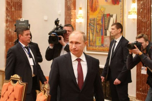 Russian President Vladimir Putin  arrives for the four-way peace talks on the Ukraine crisis in Minsk, Belarus, on Feb. 11, 2015. Four-way peace talks on the Ukraine crisis resumed here Wednesday in the Belarusian capital as heads of state and government of Russia, France, Germany and Ukraine were joined by their respective entourages.
