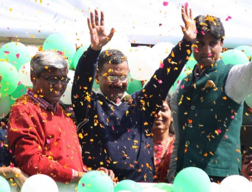 Aam Aadmi Party (AAP) leaders Arvind Kejriwal, Ashutosh and Kumar Vishwas celebrate party's performance in the recently concluded Delhi Assembly Polls in New Delhi, on Feb 10, 2015.